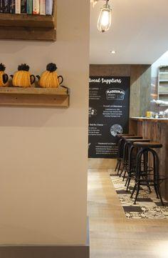 Pom's Kitchen & Deli - grey and yellow tea cosies / Deli Interiors/ Cafe Interiors/ Blackboards -  Sacha Interiors