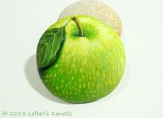 Green Apple Hand Painted Rock ! Is Painted with high quality Acrylic paints and finished with glossy varnish protection.