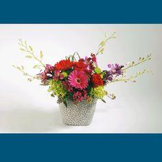 PEBBLE BEACH This arrangement includes a vibrant mix of Gerbera Daisies, Roses, Dendrobium Orchids and Hydrangea.  #MatlackFlorist