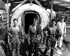 US Navy divers and their decompression chamber photographed during Pearl Harbor salvage work