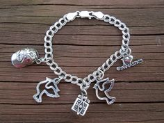 Vintage Sterling Silver Bracelet with Five Silver Charms. 6 Inches Long. Excellent Condition Ask a Question    $80.00 USD   Only 1 available