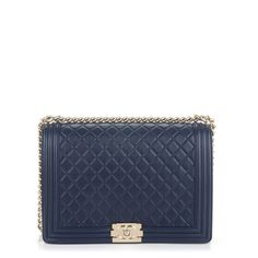 19b019f8051a This is an authentic CHANEL Lambskin Quilted Large Boy Flap in Navy. This  stylish shoulder