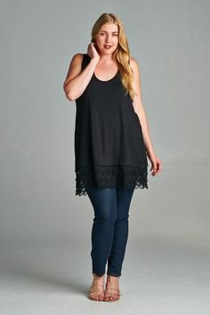 This tank with lace at the bottom is meant to be layered under any top that you would like to add length to. These are absolutely adorable and allow you to wear