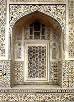 """Tomb of Itimad-ud-Daulah, Agra, India. Jali Screen Geometric Window Design, with Pietra Dura Stone Work. The Itimad-ud-Dawlah, Mausoleum of Mirza Ghiyas Beg is sometimes referred to as the """"Baby Taj."""" It is one of the finest examples of pietra dura work, making designs through the use of inlaid colored stone."""
