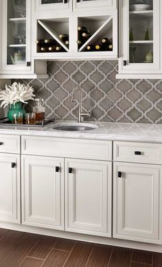 Arabesque pattern with crackle finish. Color dove grey.