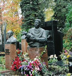 A doctor's grave...Novodevichy Cemetery / Russia.  Holding a newborn and wearing his doctor's scrubs.