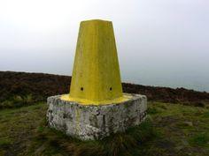 The garish yellow trig point on Longridge Fell.