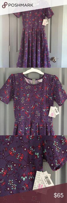 LLR Amelia dress with pockets! NWT LuLaRoe Amelia dress!  Purple background with a fun floral design!  This fabric is stretchy too! LuLaRoe Dresses Midi