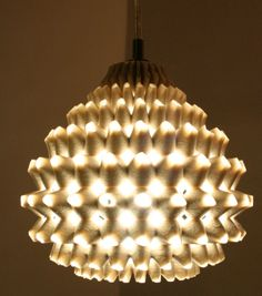 Zach Kron light fixture patterned after a garlic clove and barnacles