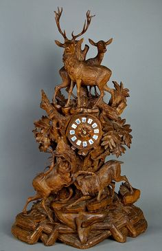 expressive carved mantel clock with a stag group, brienz ca. 1900