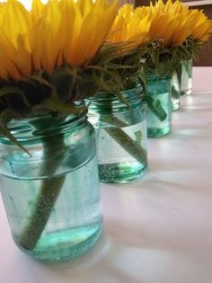 turquoise and sunflower corsage | sunflower wedding ideas...blue tinted mason jars