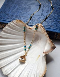 Gold seashell & Turquoise Crystals Necklace by VespertineCosmos £22 #beachjewelry #oceannecklace #seashellnecklace #bohonecklace