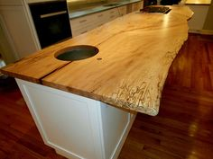 Spalted maple live edge kitchen island countertop with cooktop and undermount sink.