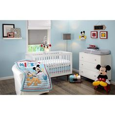 Add some cheer with your favorite mouseketeer. Make way for Mickey Mouse and his plucky pal Pluto! This adorable set features a grey, blue, and white comforter with Mickey at rest and Pluto prancing, a patterned crib sheet of blue and grey Mickey Mouse sillouette on a crisp white background, and a coordinating print and solid dust ruffle in blue, grey, and red. Coordinating items include a 4-piece bumper, additional crib sheet, Secure-Me Crib Liner, and super-soft flannel receiving blankets.
