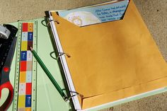 Here's an idea for creating a pocket for your notebook to hold unfinished work, loose cards, and small materials.