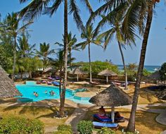 Ocean Sports- is situated on Watamu Beach, 14 miles south of Malindi town. The 29 rooms at Ocean Sports are all sea-facing. Some have views of the turquoise waters of the Indian Ocean while others, set more deeply into the Resort's 6.5 hectares, have serene views over our well-kept, colourful gardens. All rooms are air-conditioned and have large beds draped with mosquito netting. Each room has a unique African-style en-suite bathroom with a shower and toilet. 29 Rooms, Large Beds, Recreational Activities, North Coast, Turquoise Water, Colorful Garden, African Style, Beach Resorts, Kenya