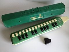 Vintage green melodica in original case (via 20thCenturyStuff, Etsy UK Vintage). I envision myself making grand, eccentric entrances whilst toodling on my melodica