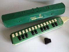 Vintage green melodica in original case (via 20thCenturyStuff, Etsy UK Vintage). I envision myself making grand, eccentric entrances whilst toodling on my melodica