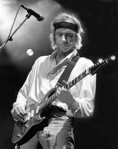 Mark Knopfler under the lights doing his thing.