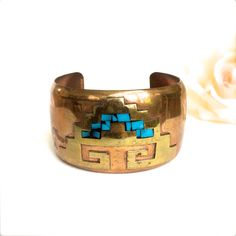 A personal favorite from my Etsy shop https://www.etsy.com/listing/235275244/copper-cuff-bracelet-with-brass-and