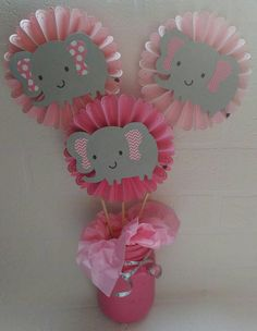 Set of three elephants on rosettes. Perfect for your elephant themed baby shower or birthday! Message me with desired colors. Outer part if ears and inner part of ears can be any color! Regular non glitter Ears $14.99 Glitter Ears $16.99 Glitter Rosettes $20.99 Glitter Ears and Rosettes $22.99 Custom orders are welcomed just send me a message with your theme and Id be happy to create your one of a kind centerpiece! Jar is not included but is available for an additional fee. Message me fo...