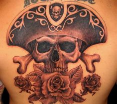 Flower And Pirate Skull Tattoo On Back