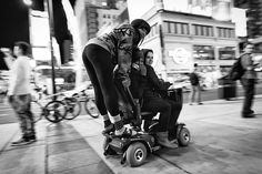 Sometimes When We're Young. Three teenage girls ride a motor assist scooter down Yonge Street near Dundas and the Eaton Center.