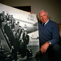 Sir Matt Busby seen here in 1984 with a photograph of the Busby Babes