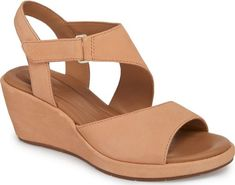 Clarks Un Plaza Wedge Sandal in Pink. Stay chic and comfortable in a lofty wedge sandal grounded by OrthoLite cushioning.. #shoes #fashion #style #stylish #trendy