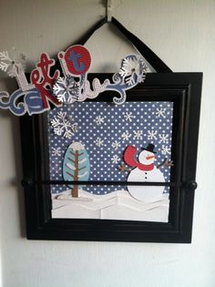 Cricut cut outs displayed in hanging picture frame