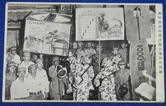 """1940's Pacific War Japanese Homefront Photo Postcard """" The advertisement group of (Osaka) Minami (south) Ward , Mitsu Town Protection Squad ( against air raid )"""" / Placards saying """"The enemy airplanes disperse poisonous gas"""" """"Do not be scared of 1000 kilograms bombs"""" """" Weight of bombs"""" (penetration power) / Group members & kimono women in traditional festival costume playing Shamisen music, 銃後 三味線 / vintage antique old Japanese military war art card / Japanese history historic paper mat"""