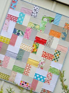 I am digging this zig zag quilt made from bright scrap fabric pieces and solid neutrals ... boy or girl friendly too