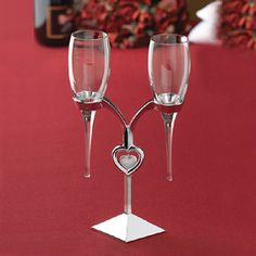 Silver Heart Stand Toasting Flutes 710309295693 Silver Heart Toasting flutes are suspended in a silver heart stand. Unique take on wedding toasting flutes. Beach Wedding Favors, Wedding Pins, Wedding Ideas, Dream Wedding, Wedding Decorations, Paris Wedding, Wedding Bells, Wedding Reception, Wedding Stuff