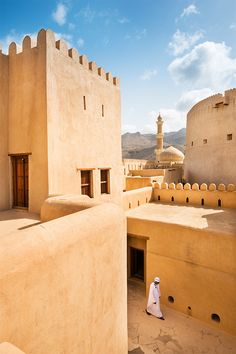 The 17th-century fort at Nizwa, a former capital of Oman at the base of its Hajar Mountains // photo by Justin Foulkes #oman #fort #town