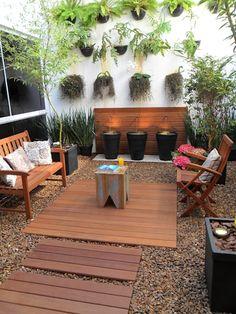Jardines de invierno de estilo moderno por Eduardo Luppi Paisagismo Ltda. https://www.homify.com.mx/libros_de_ideas/3476378/12-ideas-de-jardines-para-espacios-pequenos