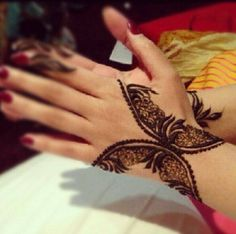 Henna on the wrists. Looks like beautiful butterflies