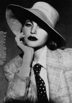 Nadja Auermann wearing a hat and a suit