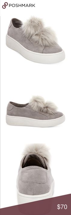 """Steve Madden Platform Sneaker 'Bryanne' Twin faux-fur puffballs adorn the laceless vamp of this sueded slip-on sneaker perched on a chunky optic-white platform. 1 1/2"""" heel; 1"""" platform Slip-on style Textile and faux-fur upper/textile lining/synthetic sole Worn a few times. Steve Madden Shoes Sneakers"""