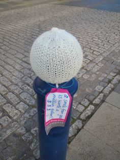 Wee bonnets on the bollards, knitted by the talented staff at Fraser Gillies, recipient of Rothesay THI shopfront funding Yarn Bombing, Creative, Fabric, Tejido, Tela, Fabrics