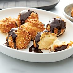 12 PROFITEROLES À LA CRÈME GLACÉE   The French classically enjoy their profiteroles filled with crème glacèe (similar to ice cream), so this version of profiteroles is celebrating the French. The delicate butter choux pastry profiteroles are filled with a rich vanilla bean crème glacèe and include 3 sachets of delicious chocolate sauce, that's best served heated and poured over. They are easy to prepare and perfect for sharing. Italian Cherries, Pizza One, Pesto Pizza, Choux Pastry, Wood Fired Oven, Profiteroles, Sachets, Delicious Chocolate, Sorbet