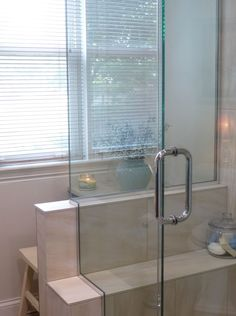 """Overall cost of bathroom, including gutting, new walls/ceiling, Congoleum floor tiles, tiled shower with ledge seat, Kohler toilet/faucets, StarMark cabinetry (cherry wood with Hazelnut stain), Vicostone quartz countertops in """"Taj Mahal"""", plumbing not moved:  $21,000. I have about $1,500 in the mirrors, towel racks, etc., from Rejuvenation.com. Sherwin Williams Steamed Milk walls, Cotton White trim.  Windows have northern exposure."""