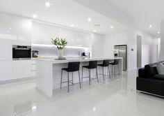 Modern Kitchen Interior White Modern Kitchen with island bench and stools, integral lighting, no handle cupboards, gloss finish throughout Open Plan Kitchen Living Room, Kitchen Room Design, Luxury Kitchen Design, Luxury Kitchens, Home Decor Kitchen, Interior Design Kitchen, Home Kitchens, Kitchen Ideas, Diy Kitchen