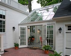 Residential Sunroom - Additional Living Space - Beautiful transition between a detached garage and living space.