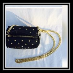 """ZARA """"mini"""" studded, spiked bag Zara special """"mini"""" studded, spiked crossbody bag. Black with gold colored studs. This little bag is going to get looks,  likes and questions everywhere you go. Beyond adorable.   long chain is 45 inches. width is 6 inches height. 4 inches depth. width is 3 1/2 inches. leather strap is 6 inches.  last two photos are to show length of bag across your shoulder.🔴Please ask any questions before purchasing. Not returnable if sizing is not right for you. Zara Bags…"""
