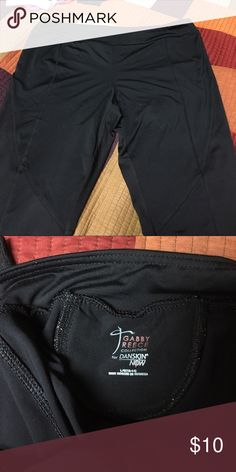 Danskin exercise pants These are work out pants. Hit right under the knee so not totally a Capri. Designed by Gabby  Reece. Key pocket in back. Size 12-14 Danskin Pants Track Pants & Joggers