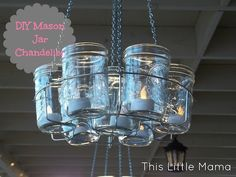 mason-jar-chandelier-diy. This is so cool! ---- I just love candles in mason jars. A few summers ago I bought a package of half-pint jars and some light wire and made wonderful little candleholders to hang among the trees; however, when I went to go set them out I got really nervous that I might set my trees—and from there my house, and from there the entire desert—on fire. So I put them away. It has recently occurred to me that replacing the tea lights with LED lig...