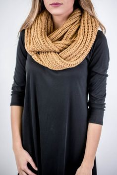 Adorable comfortable and chunky infinity scarf with knit braid detail. Perfect for keeping you cozy on those cool winter days!