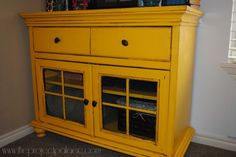 I love this bright yellow cabinet.