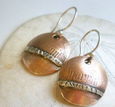 Penny Earrings with Sterling Silver . Copper Jewelry . Old Coin Jewelry . Rustic Earrings . Mixed Metal Jewelry. $26.00, via Etsy.