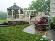 This gazebo with installed screens is built into a deck, making the enclosed structure safe from insects. It is a lovely deckside gazebo to relax under without getting bitten by bugs.